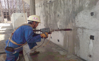 Taking core samples of concrete for crack investigation